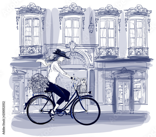Tuinposter Art Studio Happy young bicyclist riding in a street in Paris with a little dog