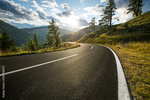 Fototapeta Asphalt road in Austria, Alps in a summer day. obraz