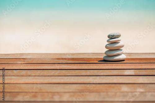 Deurstickers Stenen in het Zand Zen stones on relaxing beach background. Calmness and motivational background design