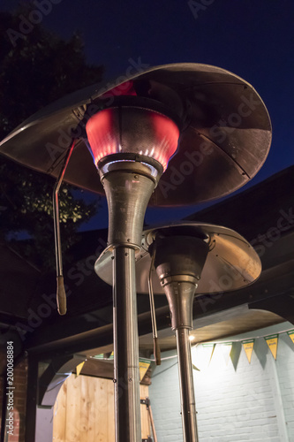 Cuadros en Lienzo Outdoor gas patio heater at night