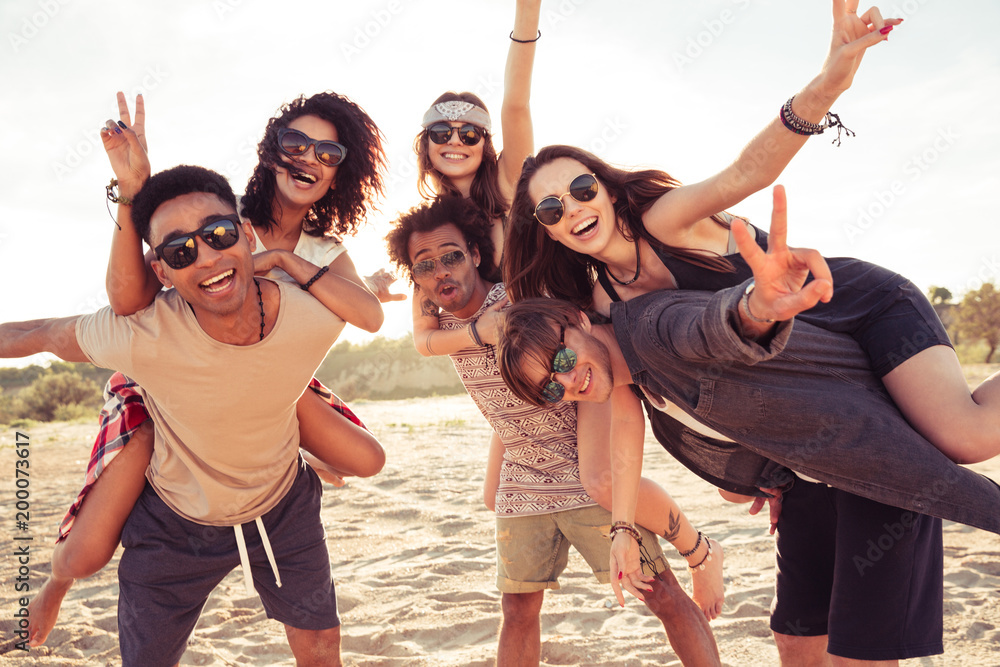 Fototapeta Happy cheerful young loving couples friends