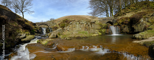 Leinwand Poster Stitched Panoramic view of the Packhorse Bridges at Three Shires Head - where Ch
