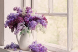 lilac in jug on old windowsill background
