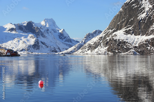 Scenery winter landscape with red buoy in the fishing village of Reine, Lofoten, Canvas Print