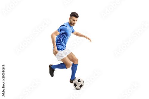 fototapeta na ścianę Soccer player dribbling