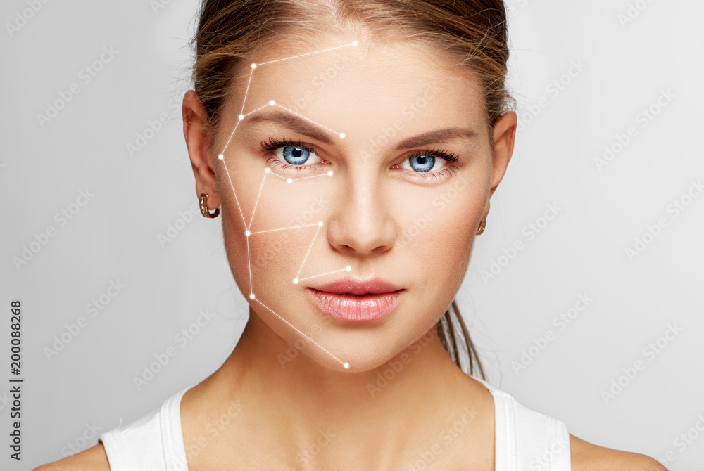 Fototapety, obrazy: Skin care and technology. Portrait of beautiful woman face with drawn massage lines.