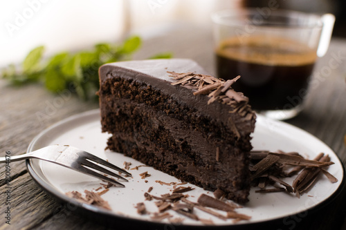 Foto op Canvas Dessert chocolate cake on wood background.