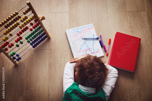 Valokuva  little boy tired stressed of doing homework