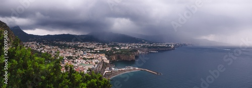 hotel on the edge of the mountain, with a view to the sea Rain clouds over beautiful Sorrento, Meta Bay in Italy, travel and vacation concept, copy space, Europe large panorama view