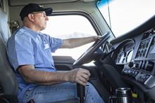 Caucasian Man Truck Driver In ...