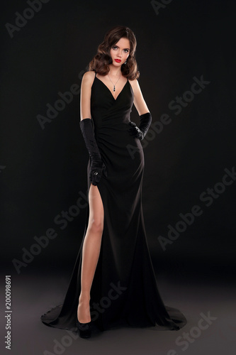 9a616ea5a Elegant lady in long sexy dress with retro wavy hairstyle posing ...