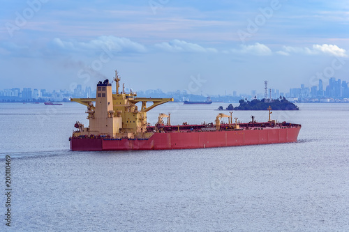 Crude oil tanker in Singapore strait - Buy this stock photo and