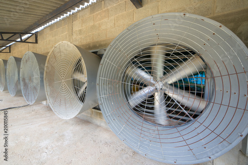 Big industrial cooler fan or cooler fan big engine in factory for reduced heat in operation. - 200115845