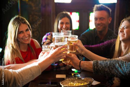 Fotografie, Obraz  Group of friends in a pub