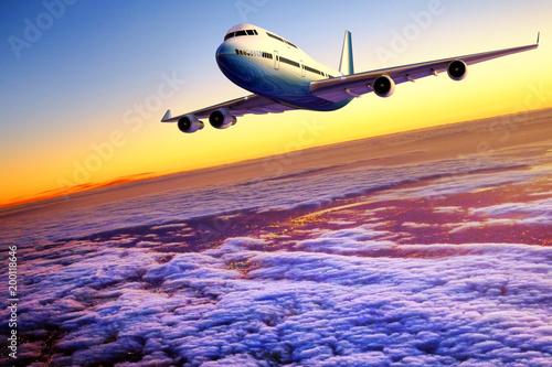 Fototapeta Airplane flying above clouds at sunset. obraz na płótnie