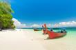White sand beach and Long-tail boat at Khang Khao Island (Bat island), The beautiful sea Ranong Province, Thailand.