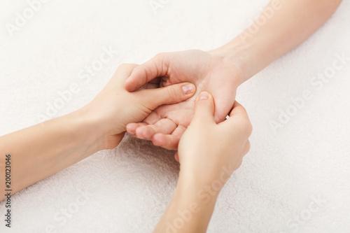 Hand massage closeup, acupressure Wallpaper Mural