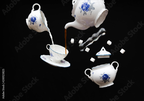 Valokuva Flying porcelain coffee set - ghost tea party on black background