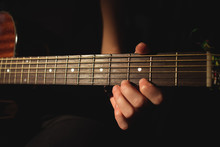Woman Playing A Guitar In Musi...