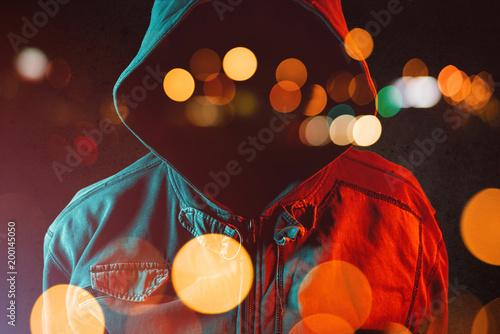 Fotografiet Faceless hooligan with hoodie in urban surrounding