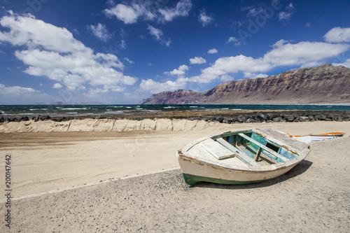 Deurstickers Canarische Eilanden Old boat on a beach