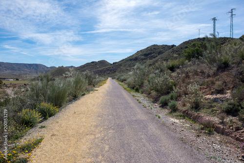 In de dag Khaki The green way of Lucainena under the blue sky in Almeria