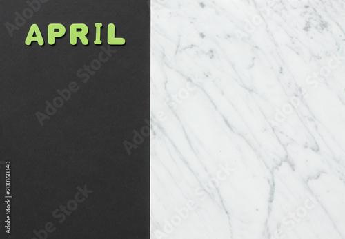 Fotografie, Obraz  Text april with green on dark background
