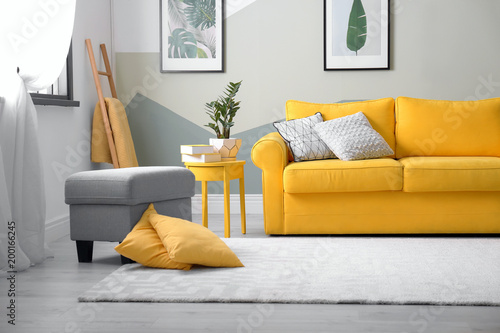 Canvastavla  Stylish living room interior with comfortable sofa