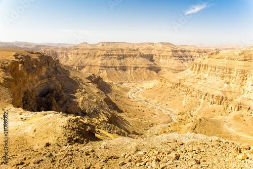 Fotobehang Midden Oosten Desert deep canyon cliffs scenic landscape view.