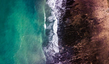 Drone View Of A Rocky Beach In Low Tide
