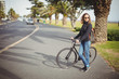 Woman standing with bicycle