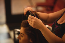 Woman Is Getting Her Hair Stra...