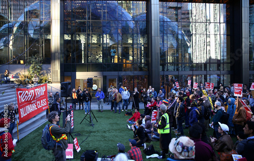 People protest in front of the Amazon Spheres to demand that