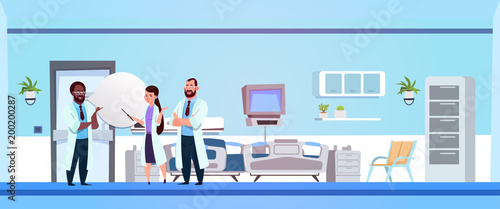 Group Of Doctors Communicating In Hospital Ward Clinic Room Interior With Bed Ba Canvas Print