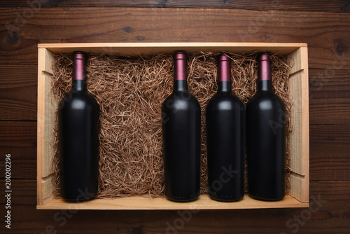 Fotografie, Obraz  Wood case of red wine bottles with one missing
