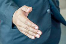 Businessman Lift Hand Up For Shake Hand