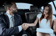 Businessman was congratulated in the car for completing the job