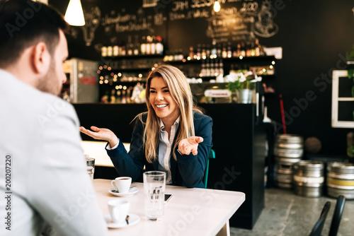 Fotografia, Obraz  Smiling blonde businesswoman enjoying on a first date.