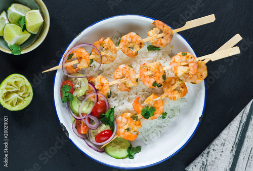 Tandoori prawn skewers with rice and chopped salad - top view