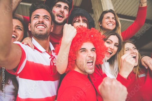 fototapeta na ścianę Football fans supporting their team at the arena for the world championship,