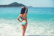 Beautiful girl is standing on the beach after swimming. Happy wo