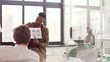 business, technology and software development concept - man showing user interface mockup to creative team at office