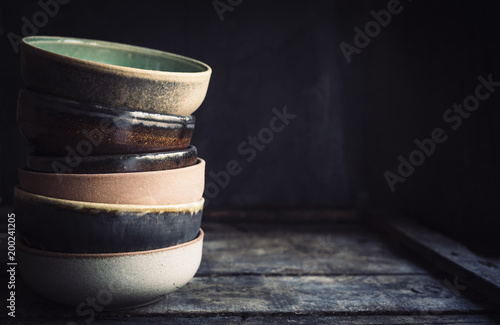 Fotomural  Ceramic bowles on the wooden background with blank space,selective focus