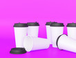 Leinwandbild Motiv paper cups tamplate 3d with a lid standing on a plane under natural light. Purple background. Rendering.