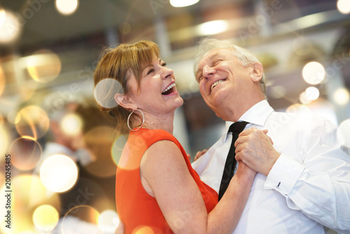Tuinposter Dance School Romantic senior couple dancing together at dance hall