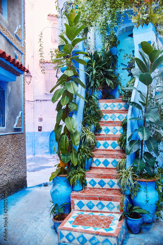 Staande foto Afrika Morocco is the blue city of Chefchaouen, endless streets painted in blue color. Lots of flowers and Souvenirs in the beautiful streets of Chefchaouen. A magical fairy-tale city of heavenly color