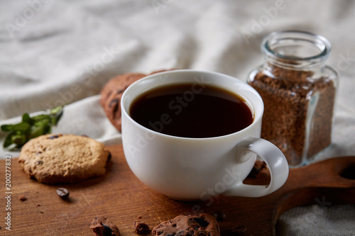 Foto op Plexiglas Chocolade Breakfast background with mug of fresh coffee, homemade oatmeal cookies, grind coffee