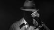 Noir film investigator standing in the dark