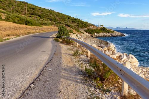 Foto op Aluminium Strand Asphalt road along sea on eastern side of Zakynthos island in sunny summer morning. Greece