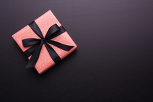 Hands Holding Wrapped Gift Box...